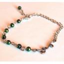Bratara Perle de Sticla Verde-Inchis cu Pandantiv Ramura Argintie cu Frunzulite